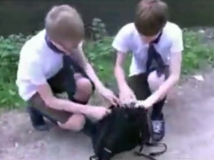 Bareback Russian boys fucking together in forest