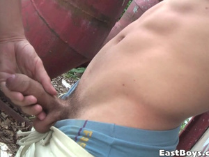 Twink with sexy haircut is showing uncut dick outdoors