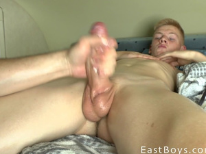 Blonde twink is burning in passion from having smooth handjob