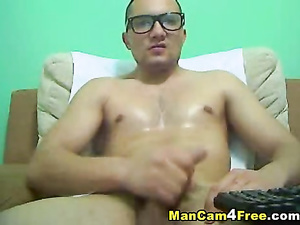 Gay in glasses is hotly masturbates on gay porn